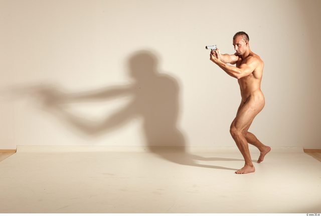 Whole Body Man Fighting poses Nude Athletic Fighting Studio photo references