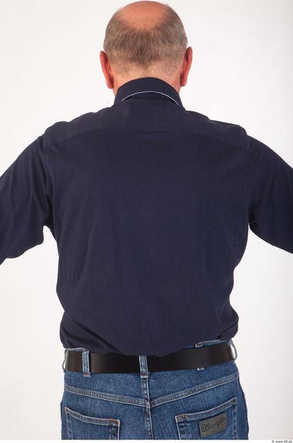 Upper body deep blue shirt of Ed