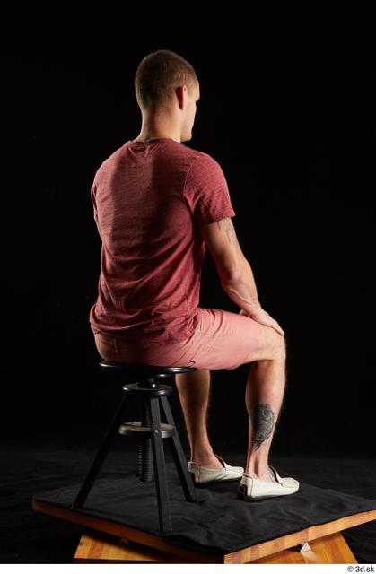 Whole Body Man White Shirt Shorts Athletic Sitting Studio photo references