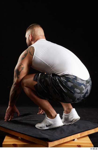 Whole Body Man White Sports Shorts Muscular Kneeling Top Studio photo references