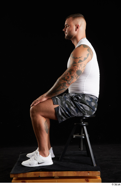 Whole Body Man White Sports Shorts Muscular Sitting Top Studio photo references
