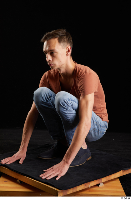 Whole Body Man White Casual Shoes Shirt Jeans Slim Kneeling Street photo references