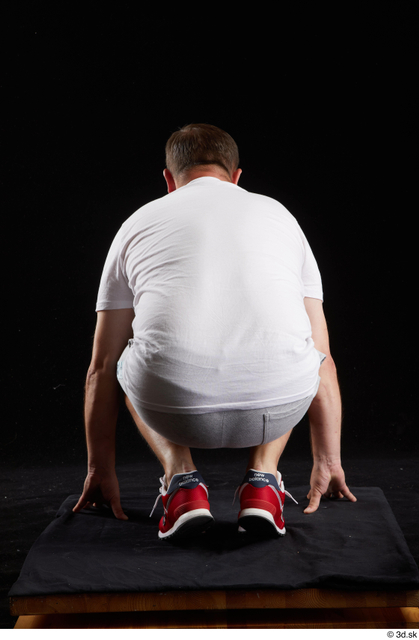 Whole Body Man White Sports Shirt Shorts Chubby Kneeling Studio photo references
