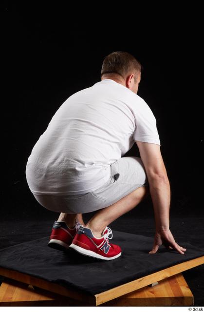 Whole Body Man White Sports Shirt Shorts Chubby Kneeling Studio photo references