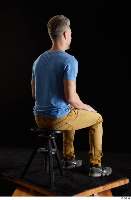Whole Body Man White Casual Shirt Jeans Slim Sitting Studio photo references