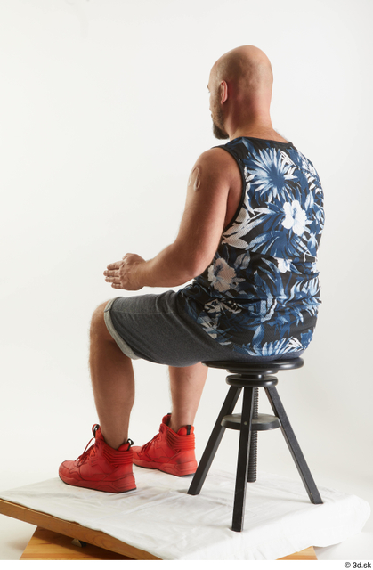 Whole Body Man White Sports Shorts Average Sitting Top Studio photo references