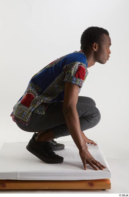 Whole Body Man Black Shirt Pants Slim Kneeling Studio photo references