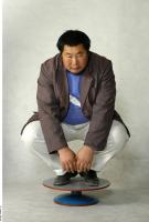 Whun Chu poses