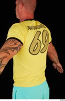 Upper body yellow shirt turquoise shorts brown shoes of Leland 0007