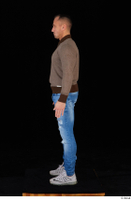 Arnost blue jeans brown sweatshirt clothing standing whole body 0003.jpg