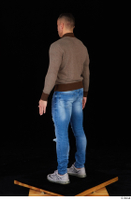 Arnost blue jeans brown sweatshirt clothing standing whole body 0004.jpg