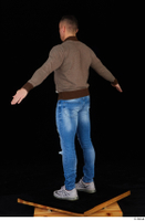 Arnost blue jeans brown sweatshirt clothing standing whole body 0012.jpg