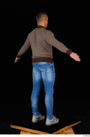 Arnost blue jeans brown sweatshirt clothing standing whole body 0014.jpg