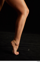 Victoria Pure  1 calf flexing nude side view 0003.jpg