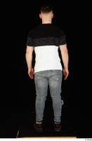 Torin blue jeans brown shoes standing t shirt whole body 0005.jpg