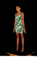 Luna Corazon dressed green patterned dress standing whole body 0002.jpg