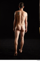 Falco White  1 back view nude walking whole body 0002.jpg