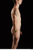 Falco White  1 arm flexing nude side view 0001.jpg