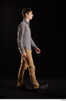 Falco White  1 black shoes brown trousers dressed grey shirt side view walking whole body 0001.jpg