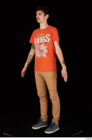 Falcon White blue sneakers brown trousers casual dressed orange t shirt standing whole body 0002.jpg