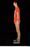 Falcon White blue sneakers brown trousers casual dressed orange t shirt standing whole body 0003.jpg