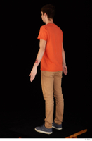Falcon White blue sneakers brown trousers casual dressed orange t shirt standing whole body 0004.jpg