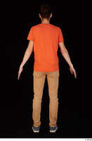Falcon White blue sneakers brown trousers casual dressed orange t shirt standing whole body 0005.jpg