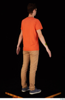 Falcon White blue sneakers brown trousers casual dressed orange t shirt standing whole body 0006.jpg