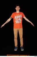 Falcon White blue sneakers brown trousers casual dressed orange t shirt standing whole body 0009.jpg
