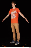 Falcon White blue sneakers brown trousers casual dressed orange t shirt standing whole body 0010.jpg