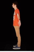 Falcon White blue sneakers brown trousers casual dressed orange t shirt standing whole body 0011.jpg