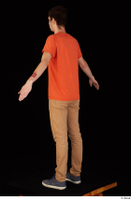 Falcon White blue sneakers brown trousers casual dressed orange t shirt standing whole body 0012.jpg