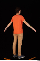 Falcon White blue sneakers brown trousers casual dressed orange t shirt standing whole body 0014.jpg