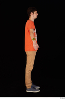 Falcon White blue sneakers brown trousers casual dressed orange t shirt standing whole body 0015.jpg
