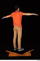 Falcon White blue sneakers brown trousers casual dressed orange t shirt standing whole body 0022.jpg