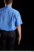 Paul Mc Caul  1 arm back view black trousers blue shirt business dressed flexing 0001.jpg