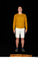 Paul Mc Caul blue shoes casual dressed standing white shorts whole body yellow sweatshirt 0001.jpg
