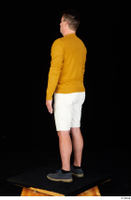 Paul Mc Caul blue shoes casual dressed standing white shorts whole body yellow sweatshirt 0004.jpg