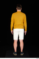 Paul Mc Caul blue shoes casual dressed standing white shorts whole body yellow sweatshirt 0005.jpg