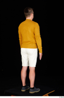 Paul Mc Caul blue shoes casual dressed standing white shorts whole body yellow sweatshirt 0006.jpg