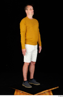 Paul Mc Caul blue shoes casual dressed standing white shorts whole body yellow sweatshirt 0008.jpg