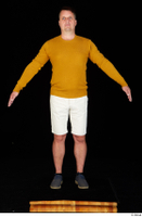 Paul Mc Caul blue shoes casual dressed standing white shorts whole body yellow sweatshirt 0009.jpg