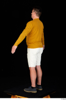 Paul Mc Caul blue shoes casual dressed standing white shorts whole body yellow sweatshirt 0012.jpg