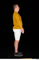 Paul Mc Caul blue shoes casual dressed standing white shorts whole body yellow sweatshirt 0015.jpg