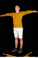 Paul Mc Caul blue shoes casual dressed standing white shorts whole body yellow sweatshirt 0018.jpg