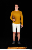 Paul Mc Caul blue shoes casual dressed standing white shorts whole body yellow sweatshirt 0025.jpg