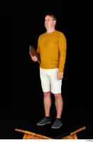 Paul Mc Caul blue shoes casual dressed standing white shorts whole body yellow sweatshirt 0026.jpg