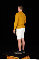 Paul Mc Caul blue shoes casual dressed standing white shorts whole body yellow sweatshirt 0028.jpg