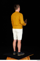 Paul Mc Caul blue shoes casual dressed standing white shorts whole body yellow sweatshirt 0030.jpg