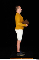 Paul Mc Caul blue shoes casual dressed standing white shorts whole body yellow sweatshirt 0031.jpg